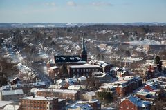 Overview small East Coast town. As Lancaster Pennsylvania sits quietly covered in snow after the polar vortex cooled off the town and left this idyllic image Royalty Free Stock Photo