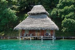 Overwater bungalow with thatch roof in Panama Stock Photography