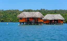 Overwater bungalow with thatched roof Royalty Free Stock Images