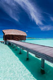 Overwater bungalow on tropical island lagoon Royalty Free Stock Photos