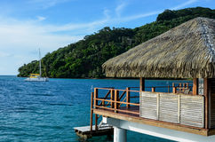 Overwater bungalow in the tropics Royalty Free Stock Photography