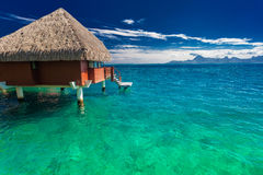 Overwater bungalows with best beach for snorkeling, Tahiti royalty free stock images