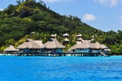Overwater Bungalows in Bora Bora. View from the ocean of overwater bungalows on the French Polynesian island of Bora Bora, Tahiti stock photos