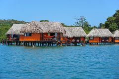 Overwater bungalows on Caribbean coast of Panama. Overwater bungalows with thatched roof on the Caribbean coast of Panama, Bocas del Toro, Central America stock image
