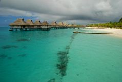 Overwater bungalows in a cloudy day. Bora Bora, French Polynesia. Bora Bora is an island in the Leeward group of the Society Islands of French Polynesia, an royalty free stock photos