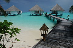 Overwater bungalows on Gangehi island, Maldives stock photos