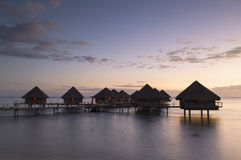 Overwater bungalows at Le Meridien Tahiti Hotel, Pape'ete, Tahiti, French Polynesia. View of overwater bungalows at Le Meridien Tahiti Hotel at sunset, Pape'ete royalty free stock image