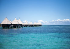 Overwater bungalows at paradise beach resort Royalty Free Stock Photo