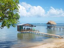 Overwater Bungalows in Punta Gorda. View of Over-water bungalows, beach and horizon in Punta Gorda, Roatan stock images