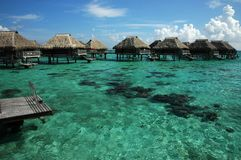Overwater bungalows in South Pacific Stock Photos