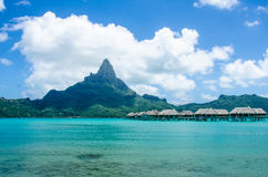 Overwater bungalows in South Pacific. Overwater bungalows in Bora Bora with view of Mount Otemanu Stock Image