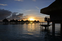 Overwater Bungalows at Sunrise stock photo