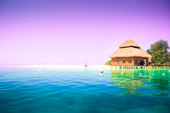 Overwater bungalows on the tropical island resort stock photos