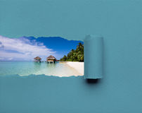 Overwater bungalows on the tropical island resort. In torn grey paper stock photos