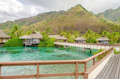 Overwater Bungalows on a tropical paradise beach in French Polyn Stock Photo
