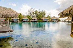 Overwater Bungalows on a tropical paradise beach in French Polyn Stock Photos