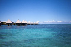 Overwater spa and bungalows in tropical blue lagoon Stock Images