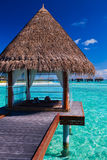 Overwater spa and bungalows in tropical lagoon. Overwater spa and bungalows in tropical blue lagoon stock photography