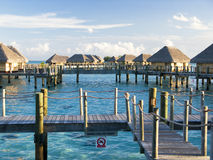 Overwater at sunset. Overwater bungalows with shadows and light of sunset Royalty Free Stock Image
