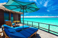 Overwater villa balcony overlooking green tropical lagoon Royalty Free Stock Photography