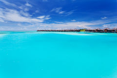 Overwater villas in blue laggon of Maldives Royalty Free Stock Photography