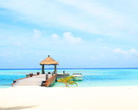 Overwater villas in blue tropical lagoon Stock Photography