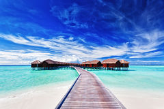 Overwater villas on the lagoon royalty free stock photos