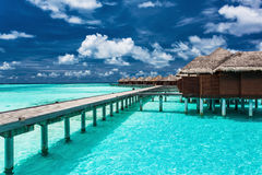 Overwater villas on the tropical lagoon with jetty Stock Photography
