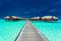 Overwater villas on the tropical lagoon, Maldives Stock Photos