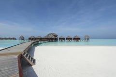 Overwaterbungalowwen in de Maldiven Stock Afbeelding