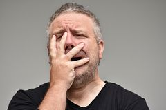 Overweight Male Under Stress. An overweight and adult male Stock Photo