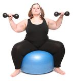 Overweight bodybuilder woman with blue ball. Royalty Free Stock Photo