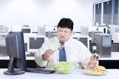 Overweight businessman avoid junk food Stock Images