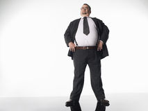 Overweight Businessman With Hands On Hips Royalty Free Stock Images