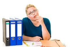 Overweight businesswoman enjoying eating chocolate Royalty Free Stock Photo