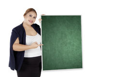 Overweight businesswoman showing banner. Portrait of overweight businesswoman showing an empty banner for advertisement Royalty Free Stock Photo