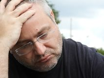 Forgetful Unshaven Caucasian Person. An overweight caucasian adult male Royalty Free Stock Images