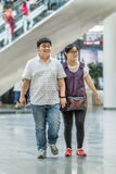 Overweight couple in shopping mall, Beijing, China royalty free stock images