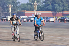 Overweight cyclists commuting in the early morning, Beijing, china Royalty Free Stock Photo