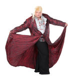 Overweight entertainer or disillusioned drag queen. With a cheap blonde wig and flowing robe over long a black skirt, humorous portrait on a white Stock Image