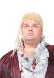 Overweight entertainer or disillusioned drag queen. With a cheap blonde wig and flowing robe over long a black skirt, humorous portrait on a white Stock Images