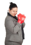 Overweight, fat businesswoman in boxing gloves Royalty Free Stock Images