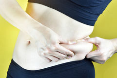 Overweight fat woman, Middle-aged woman with excessive belly fat. Side view of woman muffin top waistline Stock Images