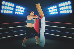Overweight female fighting with a cigarette Royalty Free Stock Photo