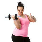 Overweight fitness girl doing thumbs up. Stock Photos