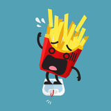 Overweight french fries character on weight scale Royalty Free Stock Photo