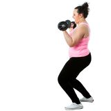 Overweight girl doing workout. Stock Images