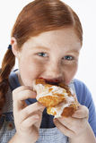 Overweight Girl Eating Pastry. Closeup portrait of an overweight girl eating pastry stock photography