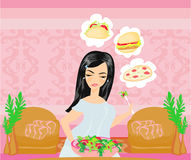 Overweight girl eats a salad but dreams of eating fast food Royalty Free Stock Images