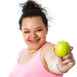 Overweight girl holding green apple. Close up portrait of overweight teen girl holding green apple.isolated on white background stock photos